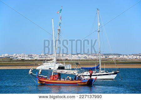 Alvor, Portugal - June 7, 2017 - Tourists Aboard A Wooden Tour Yacht On The Estuary, Alvor, Algarve,