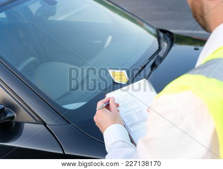 Police officer giving a ticket fine for parking violation poster