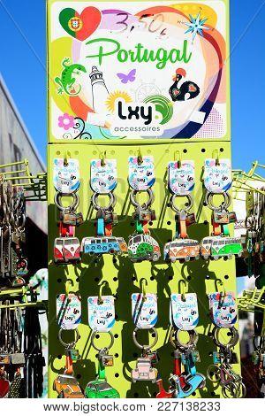 Alvor, Portugal - June 7, 2017 - Display Rack Of Car Key Rings Outside A Village Shop, Alvor, Algarv
