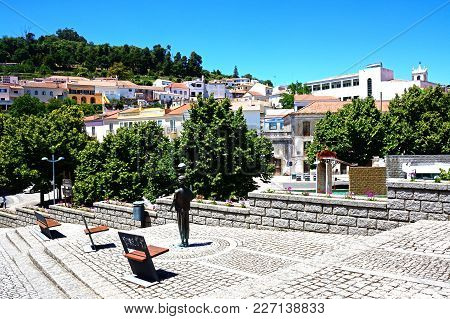 Monchique, Portugal - June 7, 2017 - View Of The Town Buildings With A Modern Art Statue In The Fore