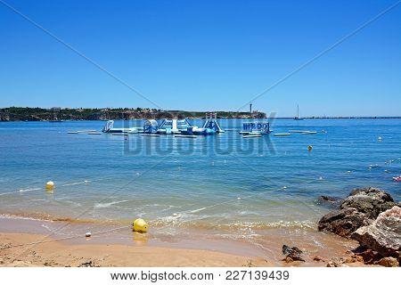 Portimao, Portugal - June 7, 2017 - Inflatable Water Park In The Sea, Portimao, Algarve, Portugal, E