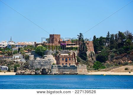 View Of A Fort Above The Beach Along The Arade River, Portimao, Algarve, Portugal, Europe.