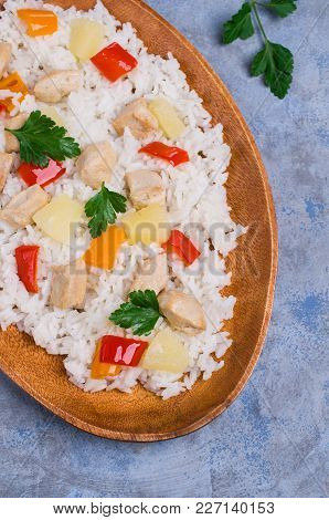 White Rice With Chicken, Pepper And Pineapple In A Plate On The Table. Selective Focus.