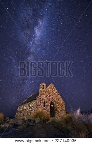 Long Exposed Night Shot In Tekapo, South Island New Zealand With Milkyway In The Background Of Churc