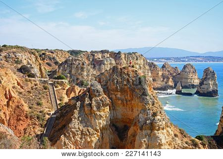 Ponta Da Piedade - June 8 2017 - Elevated View Of The Rugged Coastline With Steps Leading To The Bea