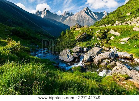 Wild Stream Among The Rocks. Beautiful Composite Landscape With Grassy Hills In Summer. Mountain Rid