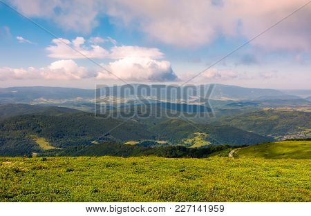 Grassy Meadow On Hillside On A Cloudy Day. Beautiful Mountainous Landscape In Summertime. Location R