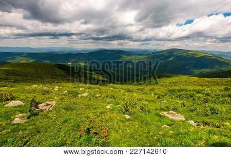 Boulders On The Hillside. Mountain Summer Landscape. Meadow With Huge Stones Among The Grass On Top