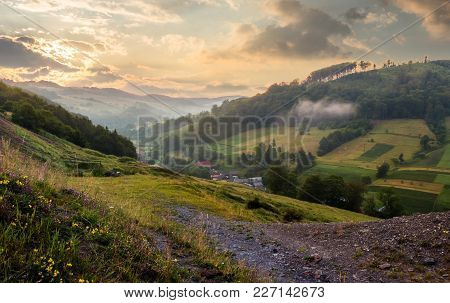 Rural Valley With Forested Hills At Sunrise. Beautiful Summer Landscape In Carpathian Mountains