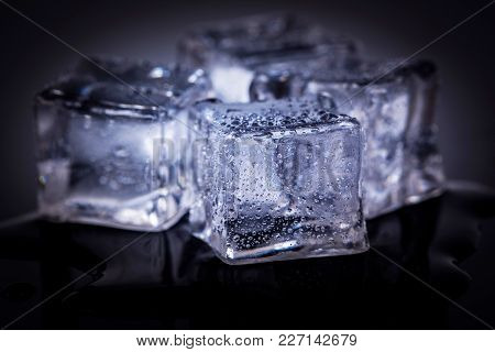 Many Ice Cubes On Black Reflection Background