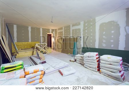 Materials For Constraction (putty Packs, Sheets Of Plasterboard Or Drywall)  In Apartment Is Under C