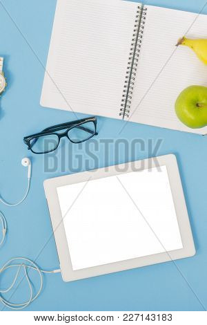 Tablet Blank Screen On Blue Background, Top View. Education Background