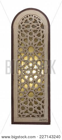 Perforated Arched Stucco Window Decorated With Stain Glass With Geometrical Patterns, One Of The Tra