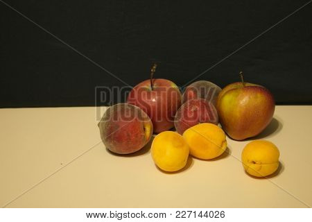 Red Apples And Peaches Light Table Dark Background