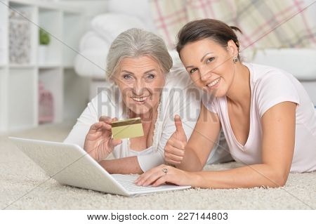 Mother And Her Adult Daughter Using Laptop, Online Shopping Concept