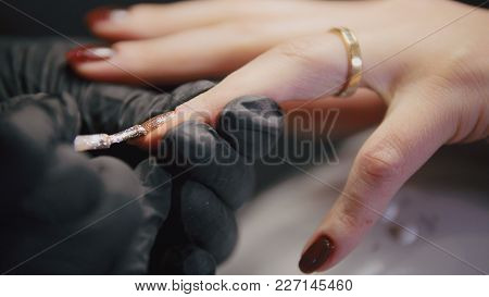 Working Manicurist - Nail Master In Medical Mask Doing Professional Manicure, Telephoto
