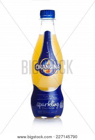 London, Uk - February 14, 2018: Plastic Bottle Of Orangina Sparkling Fruit Soda Drink On White Backg
