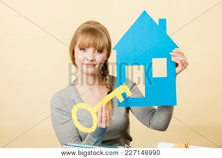 Plans Ideas And Concepts For Future. Young Joyful Blonde Woman With House And Big Key. Charming Girl