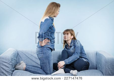 Two Women After Being Mad At Each Other One Feeling Offended. Female Being Pained.