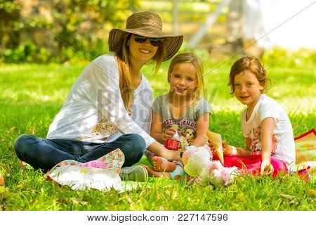 Johannesburg, South Africa, 05/09/2015,  Mother And Daughters Sitting On A Picnic Blanket At The Win