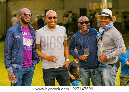 Johannesburg, South Africa, 05/09/2015,  African Men Posing For A Photo At The Winter Sculpture Fair