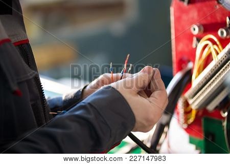 Electrician Works With Electric Wires - Industrial Equipment