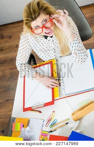 Shocked Accountant Business Woman Sitting Working At Desk Full Off Documents In Binders Seeing Somet
