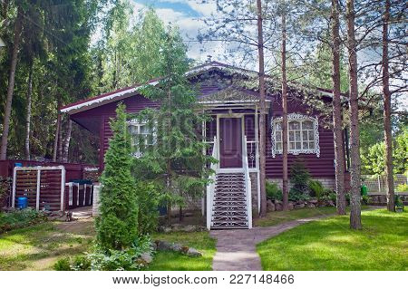 A Beautiful Village House With Its Garden  In A Rural Area