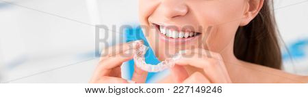 Woman Wearing Orthodontic Silicone Trainer. Invisible Braces Aligner. Mobile Orthodontic Appliance F