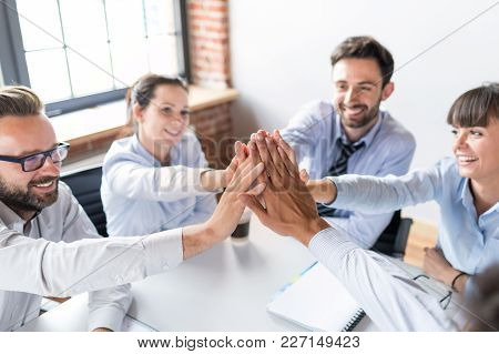 Business People Happy Showing Team Work And Giving Five In Office. Teamwork Concepts.