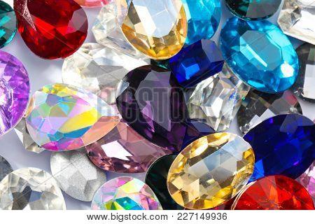 Precious jewels as background, closeup