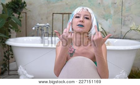 Beautiful Lady In Wig Showing Middle Finger In The Bathroom.