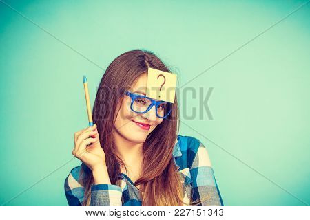 Thinking Woman With Big Nerdy Eyeglasses And Question Mark On Forehead. Creating New Idea, Studying