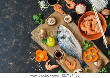 Products For Cooking. Asian Cuisine And Mediterranean Cuisine. Fish, Shrimp, Mushrooms. Top View, Co