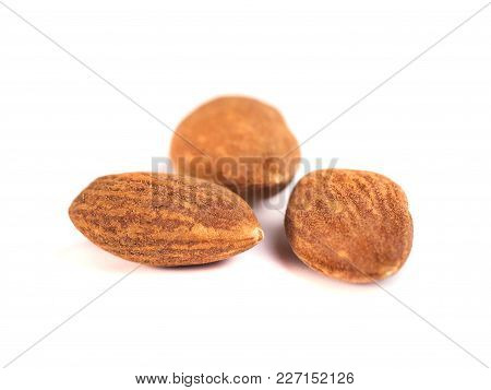 Brown Roast Almonds On White Background
