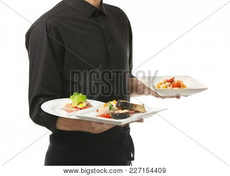 Waiter holding plates with dishes on white background
