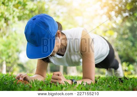 Hand Push-up. Confident Muscled Young Women Wearing Sport Wear And Doing Hand Push-up While Exercisi