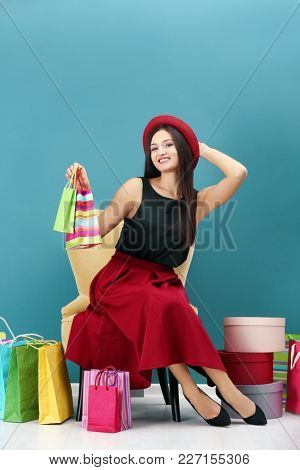 Beautiful woman after successful shopping indoors