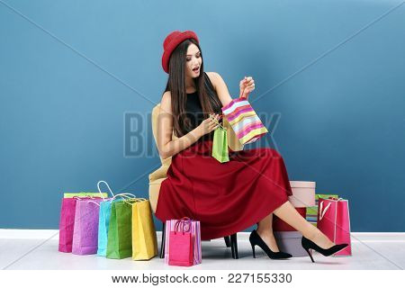 Emotional woman after successful shopping indoors