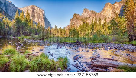 Panoramic View Of Famous Yosemite Valley With Scenic Merced River In Beautiful Golden Evening Light