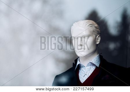 Male Mannequin Wearing Fashionable Shirt And Coat. Mannequin Head In Boutique. Dummy In Glass Showca