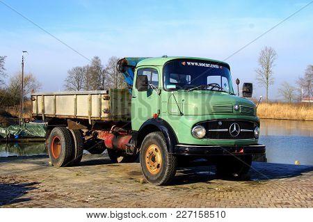 Dronten, The Netherlands - February 18, 2018: Green Mercedes-benz 1413 Tipper Truck.