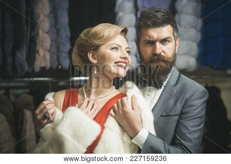 Business Meeting, Moneybags. Couple In Love Among Fur Coat, Luxury. Woman In Fur Coat With Man, Shop