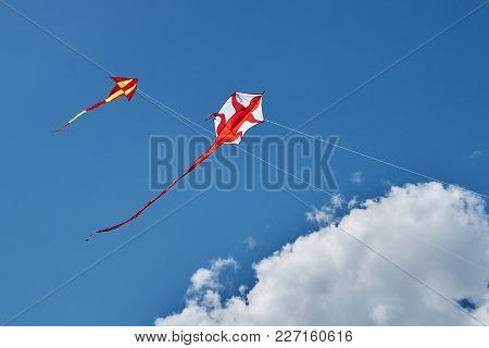Two Kites In Blue Sky. Photo From Kites Carnival