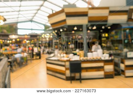 Abstract Blurred Food Court In Department Store.