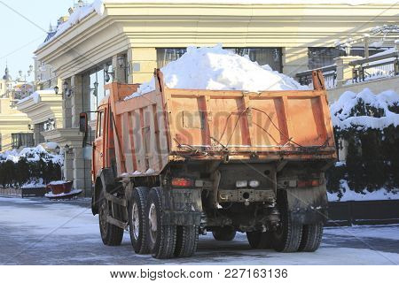 Truck Carrying The Snow On The Street In Winter, Urban Landscape