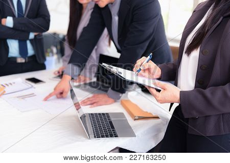 Businesspeople Discussing And Meeting Together In Conference Room., Business And Finance Concepts