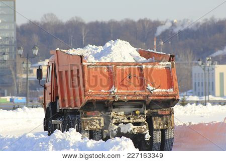 Truck Carrying The Snow On The Street In Winter, Cleaning Of Streets, Urban Landscape