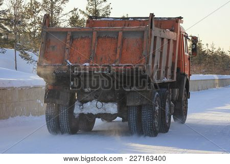 Dirty Truck Carrying The Snow On The Street In Winter, Urban Landscape