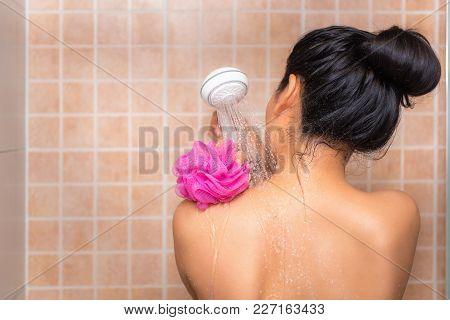 Portrait Of Beautiful Woman Taking Shower With Bath Sponge.